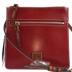 Dooney and Bourke Double zipper cross body purse.